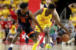 Illinois guard Andres Feliz (10) and Maryland forward Makhi Mitchell (21) compete for a the ball during the first half of an NCAA college basketball game, Saturday, Dec. 7, 2019, in College Park, Md. (AP Photo/Julio Cortez)