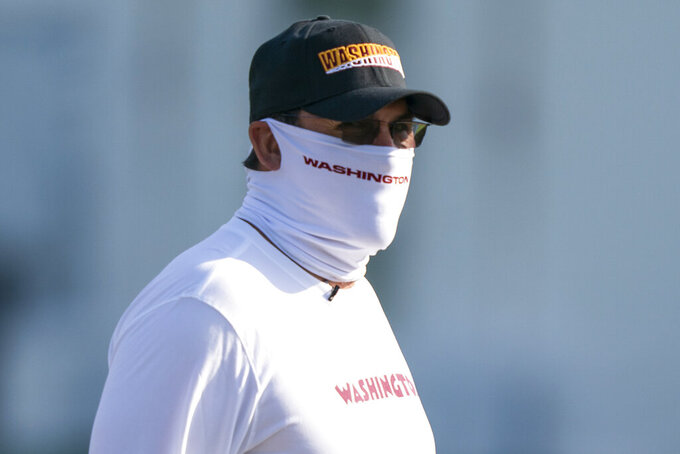 Washington head coach Ron Rivera arrives for practice wearing a face mask, at the team's NFL football training facility, Thursday, Aug. 20, 2020, in Ashburn, Va. (AP Photo/Alex Brandon)