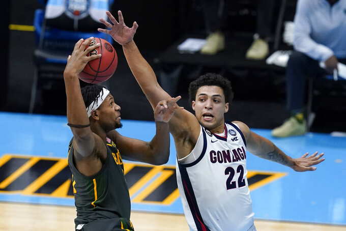 Baylor forward Flo Thamba is fouled by Gonzaga forward Anton Watson (22) while driving to the basket during the second half of the championship game in the men's Final Four NCAA college basketball tournament, Monday, April 5, 2021, at Lucas Oil Stadium in Indianapolis. (AP Photo/Darron Cummings)
