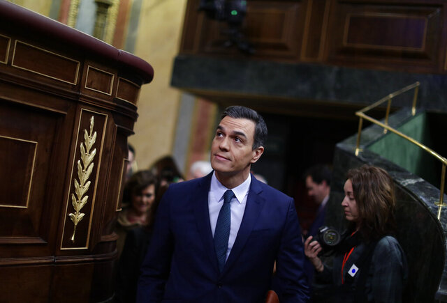 Spain's caretaker Prime Minister Pedro Sanchez arrives at the Spanish Parliament in Madrid, Spain, Sunday, Jan. 5, 2020. Sanchez is not expected to clinch an absolute majority during a first round of voting on Sunday but the Socialists insist they have the votes needed to get the required simple majority in a second vote Tuesday to put Sanchez back in the Moncloa Palace. (AP Photo/Manu Fernandez)