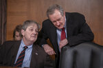 Sen. John Kennedy, R-La., left, talks with Senate Finance Committee Chairman Mike Crapo, R-Idaho, as they prepare to hear from President Donald Trump's nominee to the Federal Reserve, Judy Shelton, during her confirmation hearing, on Capitol Hill in Washington, Thursday, Feb. 13, 2020. (AP Photo/J. Scott Applewhite)