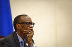 Rwanda's President Paul Kagame listens to questions from the media at a press conference at a convention center in the capital Kigali, Rwanda Monday, April 8, 2019.  Rwanda on Sunday commemorated the 25th anniversary of when the country descended into an orgy of violence in which some 800,000 Tutsis and moderate Hutus were massacred by the majority Hutu population over a 100-day period in what was the worst genocide in recent history. (AP Photo/Ben Curtis)
