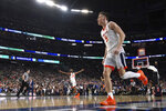 Virginia's Mamadi Diakite, left, and Kyle Guy, right, celebrate at the end of a semifinal round game against Auburn in the Final Four NCAA college basketball tournament, Saturday, April 6, 2019, in Minneapolis. (AP Photo/David J. Phillip)