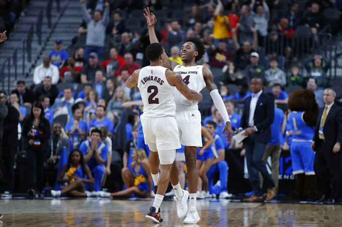 Arizona State's Rob Edwards, left, and Kimani Lawrence celebrate after Lawrence scored a 3-point shot against UCLA during the first half of an NCAA college basketball game in the quarterfinals of the Pac-12 men's tournament Thursday, March 14, 2019, in Las Vegas. (AP Photo/John Locher)