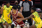 Stanford forward Jaiden Delaire (11) drives between Oregon forwards Chandler Lawson (13) and Eric Williams Jr. (50) during the first half of an NCAA college basketball game in Stanford, Calif., Thursday, Feb. 25, 2021. (AP Photo/Jeff Chiu)