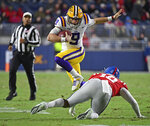 LSU quarterback Joe Burrow (9) avoids Mississippi linebacker Jacquez Jones (10) during the first half of an NCAA college football game in Oxford, Miss., Saturday, Nov. 16, 2019. (AP Photo/Thomas Graning)