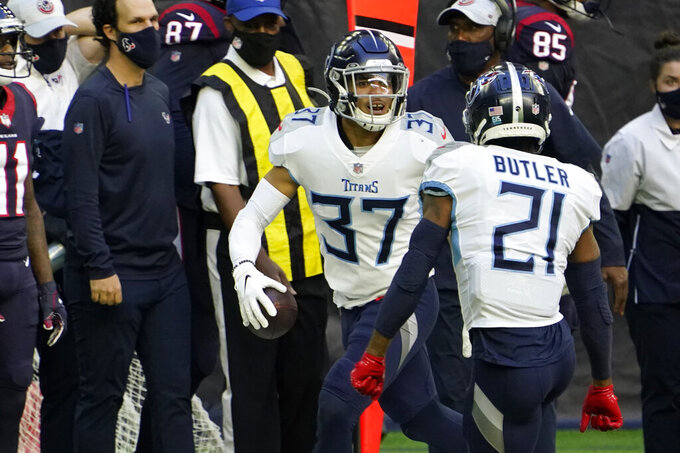 Tennessee Titans strong safety Amani Hooker (37) celebrates with Malcolm Butler (21) after intercepting a pass against the Houston Texans during the first half of an NFL football game Sunday, Jan. 3, 2021, in Houston. (AP Photo/Sam Craft)