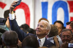 Democratic presidential candidate and former Vice President Joe Biden takes selfies with the crowd after he spoke at Hillside High School in Durham, NC on Sunday, Oct 27, 2019. Approximately 850 people attended the rally in Durham. (Bryan Cereijo/The News & Observer via AP)