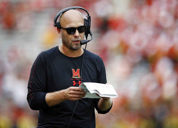FILE - In this Sept. 15, 2018, file photo, Maryland interim head coach Matt Canada walks on the field in the second half of an NCAA college football game against Temple in College Park, Md. The interim coach took over a program in turmoil and has helped the Terrapins (4-2, 2-1 Big Ten) already match last season's number of wins.  (AP Photo/Patrick Semansky, File)