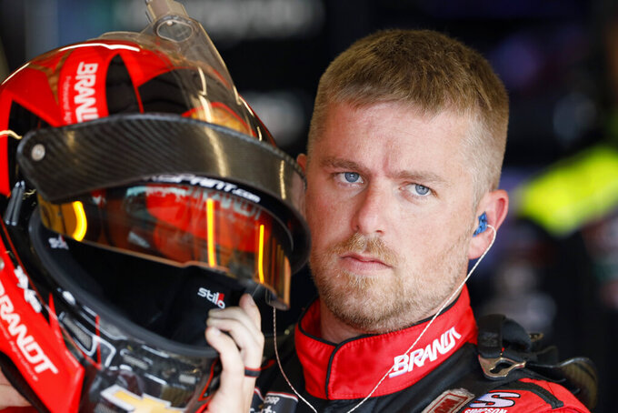 Justin Allgaier puts on his helmet for practice for a NASCAR Xfinity Series auto race, Saturday, June 15, 2019, at Iowa Speedway in Newton, Iowa. (AP Photo/Charlie Neibergall)