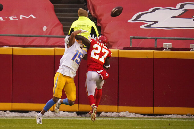 Kansas City Chiefs cornerback Rashad Fenton (27) breaks up a pass intended for Los Angeles Chargers wide receiver Jalen Guyton (15) during the first half of an NFL football game, Sunday, Jan. 3, 2021, in Kansas City. (AP Photo/Jeff Roberson)