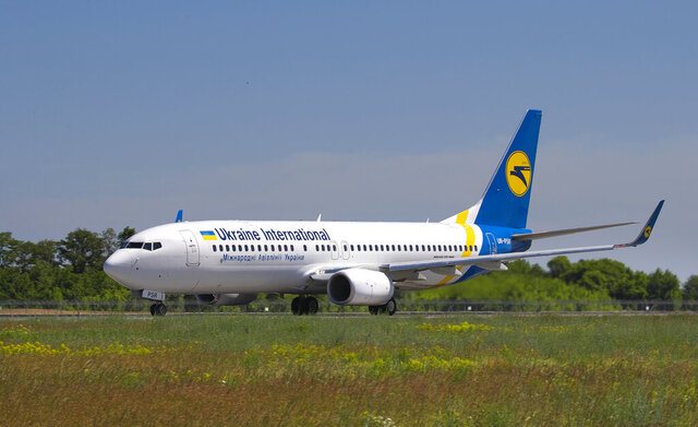 In this photo taken on Saturday, May 26, 2018, showing the actual Ukrainian Boeing 737-800 UR-PSR plane that crashed Wednesday Jan. 8, 2020, on the outskirts of Tehran, Iran, seen here as it waits to takeoff at Borispil international airport outside Kyiv, Ukraine. This Ukrainian airplane carrying 176 people crashed on Wednesday shortly after takeoff from Tehran's main airport, killing all onboard, Iranian state TV and officials in Ukraine said. (AP Photo/Oleg Belyakov)