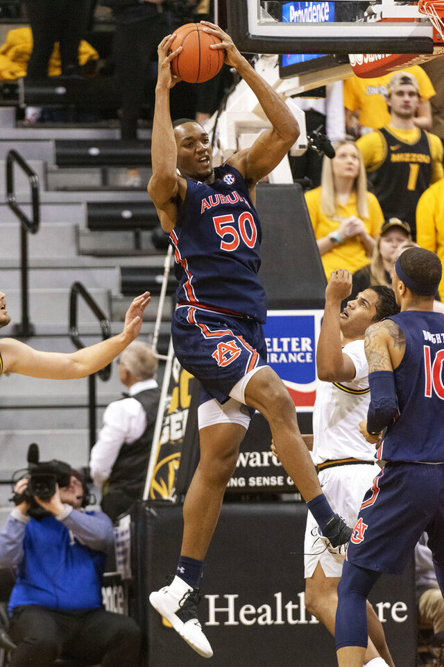 Auburn's Austin Wiley pulls down a rebound during the first half of the team's NCAA college basketball game against Missouri on Saturday, Feb. 15, 2020, in Columbia, Mo. (AP Photo/L.G. Patterson)