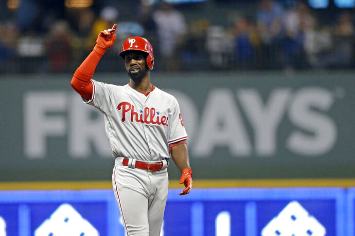 Philadelphia Phillies' Andrew McCutchen gestures after hitting an RBI double during the sixth inning of the team's baseball game against the Milwaukee Brewers on Friday, May 24, 2019, in Milwaukee. (AP Photo/Aaron Gash)