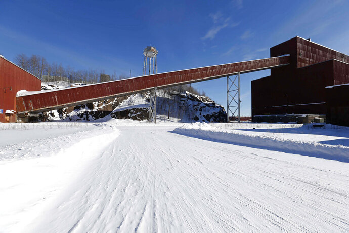 FILE - This Feb. 10, 2016 file photo shows a former iron ore processing plant near Hoyt Lakes, Minn., that would become part of a proposed PolyMet copper-nickel mine. The Minnesota Department of Natural Resources on Wednesday, Feb. 12, 2020, asked the state Supreme Court to overturn a lower court decision that rejected some of the most important permits for the proposed PolyMet copper-nickel mine. The case is one of several pending before the courts in the long-running battle over what would be Minnesota's first copper-nickel mine. (AP Photo/Jim Mone, File)