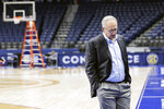 "FILE - Greg Sankey, commissioner of the Southeastern Conference, walks across the basketball court as the venue is dismantled after the remaining NCAA college basketball games in the Southeastern Conference tournament were canceled in Nashville, Tenn., due to coronavirus concerns, in this Thursday, March 12, 2020, file photo. The SEC Tournament begins Wednesday, March 10, 2021, in Nashville. ""It's good to be back,"" Sankey said. (AP Photo/Mark Humphrey)"