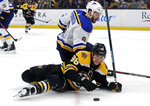 Boston Bruins right wing David Pastrnak (88) falls while chasing the puck against St. Louis Blues defenseman Joel Edmundson (6) during the second period of an NHL hockey game Thursday, Jan. 17, 2019, in Boston. (AP Photo/Elise Amendola)