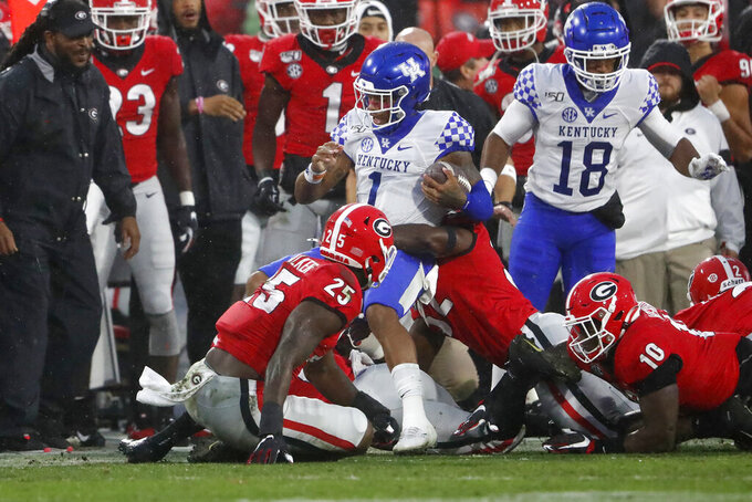 Kentucky quarterback Lynn Bowden Jr. (1) is tackled by Georgia players during the first half of an NCAA college football game Saturday, Oct. 19, 2019, in Athens, Ga. (AP Photo/John Bazemore)