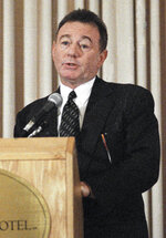FILE - Howard Weitzman, attorney for Michael Jackson, answers questions at a Los Angeles news conference on Nov. 15, 1993. Weitzman, an attorney in decades of front-page trials whose clients included Jackson, Justin Bieber, and auto maker John DeLorean, has died. Weitzman's wife says he died Wednesday, April 8, 2021, after a brief illness. He was 81. (AP Photo/Lois Bernstein, File)