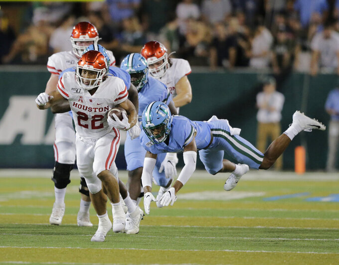 Houston running back Kyle Porter (22) gets away from Tulane safety Macon Clark (37) for a long gain during an NCAA college football game Thursday, Sept. 19, 2019, in New Orleans. (A.J. Sisco/The Advocate via AP)