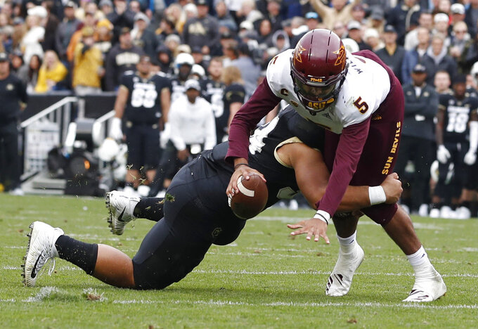 Arizona State quarterback Manny Wilkins, right, is sacked by Colorado defensive lineman Mustafa Johnson in the second half of an NCAA college football game Saturday, Oct. 6, 2018, in Boulder, Colo. Colorado won 28-21. (AP Photo/David Zalubowski)