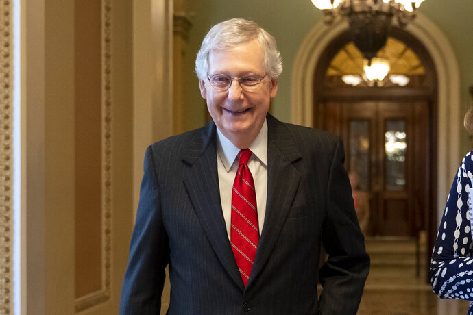 Senate Majority Leader Mitch McConnell, R-Ky., smiles after vote on a hard-won budget deal that would permit the government to resume borrowing to pay all of its obligations and would remove the prospect of a government shutdown in October, at the Capitol in Washington, Thursday, Aug. 1, 2019. (AP Photo/J. Scott Applewhite)