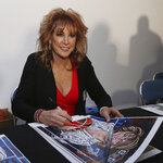 FILE - In this March 30, 2019, file photo, former professional basketball star Nancy Lieberman signs a poster before being inducted into the Texas Sports Hall of Fame in Waco, Texas.