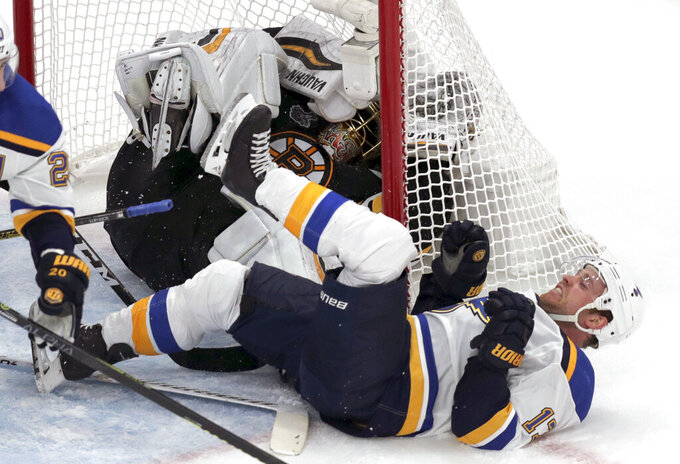 St. Louis Blues' Jaden Schwartz, front, ends up on his back and Boston Bruins goaltender Tuukka Rask, of Finland, ends up in the net during the second period in Game 2 of the NHL hockey Stanley Cup Final, Wednesday, May 29, 2019, in Boston. (AP Photo/Charles Krupa)
