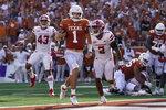Texas quarterback Hudson Card (1) runs for a touchdown against Louisiana-Lafayette during the second half of an NCAA college football game Saturday, Sept. 4, 2021, in Austin, Texas. (AP Photo/Eric Gay)