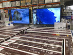 Rows of boxed big-screen televisions sit on display at a Costco warehouse in this photograph taken Wednesday, Nov. 18, 2020, in Sheridan, Colo.   Orders for big-ticket manufactured goods slow to modest gain of 1.3% in October indicating economy is slowing. (AP Photo/David Zalubowski)