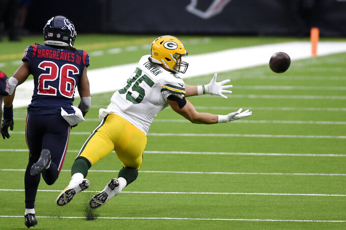 Green Bay Packers tight end Robert Tonyan (85) reaches for a pass as Houston Texans cornerback Vernon Hargreaves III (26) watches during the first half of an NFL football game Sunday, Oct. 25, 2020, in Houston. (AP Photo/Eric Christian Smith)