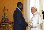 FILE - In this March 16, 2019 file photo, South Sudan President Salva Kiir Mayardit meets Pope Francis during their private audience at the Vatican. Pope Francis and the Archbishop of Canterbury marked the 10th anniversary of the independence of South Sudan on Friday, July 9, 2021, by urging its rival political leaders to make the necessary personal sacrifices to consolidate peace. (AP Photo/Alessandra Tarantino, Pool, file)