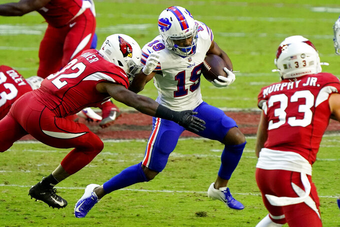 Buffalo Bills wide receiver Isaiah McKenzie (19) is hit by Arizona Cardinals strong safety Budda Baker (32) during the first half of an NFL football game, Sunday, Nov. 15, 2020, in Glendale, Ariz. (AP Photo/Rick Scuteri)