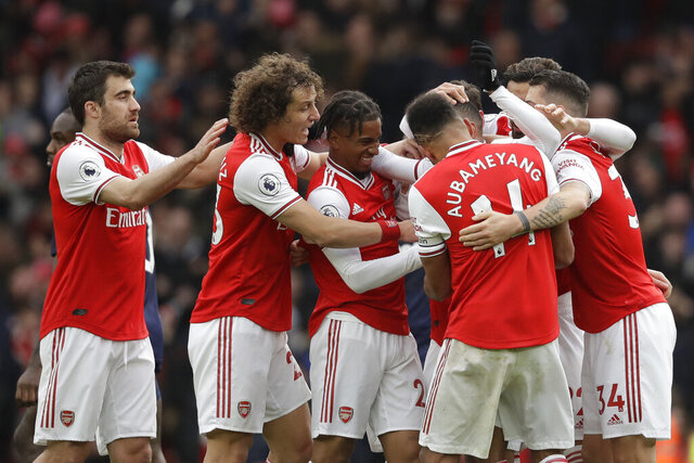 Arsenal's players celebrate a goal during the Premier League soccer match between Arsenal and West Ham at the Emirates Stadium in London, Saturday, March 7, 2020.(AP Photo/Matt Dunham)