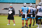Carolina Panthers special teams assistant coach Ed Foley, left, directs players during NFL football training camp practice Sunday, Aug. 16, 2020 in Charlotte, N.C. (AP Photo/Nell Redmond)