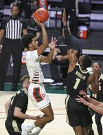 Miami guard Harlond Beverly (5) shoots over Purdue forward Aaron Wheeler (1) during the first half of an NCAA college basketball game Tuesday, Dec. 8, 2020, in Coral Gables, Fla. (Al Diaz/Miami Herald via AP)