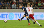 Slovakia's Albert Rusnak, left, scores his side's second goal beside Denmark's Nicolai Johansen during a friendly soccer match between Slovakia and Denmark in Trnava, Slovakia, Wednesday, Sept. 5, 2018. Every player in Denmark's squad are uncapped following a dispute between Denmark's star players and the Danish Football Association. (AP Photo/Ronald Zak)
