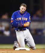 New York Mets' Jeff McNeil reacts after Miami Marlins shortstop Miguel Rojas tagged him out at second base during the seventh inning of a baseball game on Saturday, July 13, 2019, in Miami. (AP Photo/Brynn Anderson)