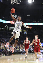 Georgia Tech guard Asanti Price soars to the basket past Elon defenders Simon Wright, center, and Zac Ervin, right, during the second half of an NCAA college basketball game on Monday, Nov. 11, 2019, in Atlanta. Georgia Tech won, 64-41. (Curtis Compton/Atlanta Journal-Constitution via AP)