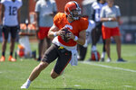 Cleveland Browns quarterback Baker Mayfield (6) rolls out to pass during an NFL football practice in Berea, Ohio, Wednesday, Aug. 4, 2021. (AP Photo/David Dermer)
