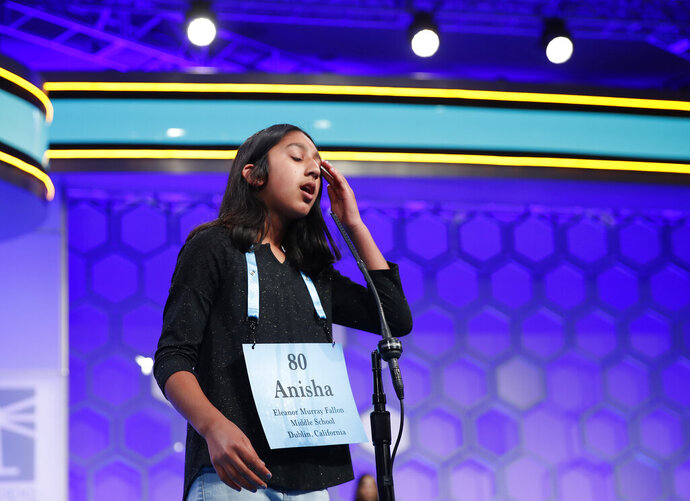 FILE - In this May 31, 2018 file photo, Anisha Rao, 12, from Dublin, Calif., reacts after spelling a word incorrectly during the evening finals of the Scripps National Spelling Bee in Oxon Hill, Md.  An unremarkable sound can be the toughest thing for spellers to master at the Scripps National Spelling Bee. It's known as the schwa. It sounds like