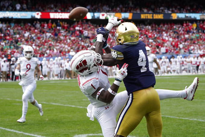 Wisconsin cornerback Faion Hicks (1) breaks up a pass intended for Notre Dame wide receiver Kevin Austin Jr. during the second half of an NCAA college football game Saturday, Sept. 25, 2021, in Chicago. Notre Dame won 41-13. (AP Photo/Charles Rex Arbogast)