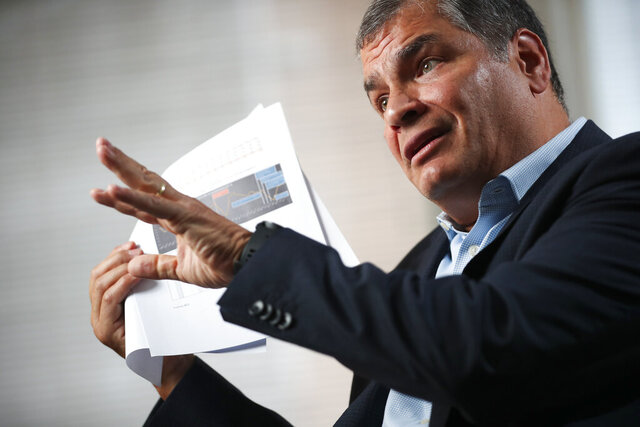 "FILE - In this Oct. 10, 2019 file photo, Ecuador's former President Rafael Correa gives an interview in Brussels, Belgium. Ecuador's prosecutor's office opened a new investigation into Correa on Feb. 6, 2020 in connection with a case titled ""Sobornos,"" or Bribes, involving alleged illegal economic contributions by private companies and entrepreneurs to his political party Country Alliance. (AP Photo/Francisco Seco, File)"