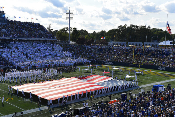 Navy's marching band performs at halftime during an NCAA college football game between Navy and Air Force, Saturday, Sept. 11, 2021, in Annapolis, Md. (AP Photo/Terrance Williams)