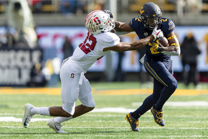 California wide receiver Jordan Duncan, right, fends off Stanford cornerback Obi Eboh in the second quarter of a football game in Berkeley, Calif., Saturday, Dec. 1, 2018. (AP Photo/John Hefti)
