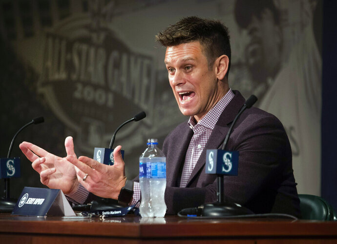 FILE - In this Jan. 24, 2019, file photo, Seattle Mariners General Manager Jerry Dipoto answers questions during a press conference in Seattle. Major League Baseball's independent investigation found no credible evidence to support claims of disparaging comments and discriminatory treatment by members of the Seattle Mariners front office. MLB said in a statement Wednesday, Feb. 6, 2019, that the investigation found the Mariners did not violate baseball's