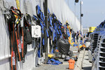 Crew members' fire suits dry out in the garage area before the restart of the NASCAR Daytona 500 auto race at Daytona International Speedway, Monday, Feb. 17, 2020, in Daytona Beach, Fla. Sunday's race was postponed because of rain. (AP Photo/Terry Renna)
