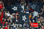 Hong Kong soccer fans wave black version of the Hong Kong flags to protest against government during the FIFA World Cup Qatar 2022 and AFC Asian Cup 2023 Preliminary Joint Qualification Round 2 soccer match between Hong Kong and Iran, in Hong Kong, Tuesday, Sept. 10, 2019. The crowd broke out into