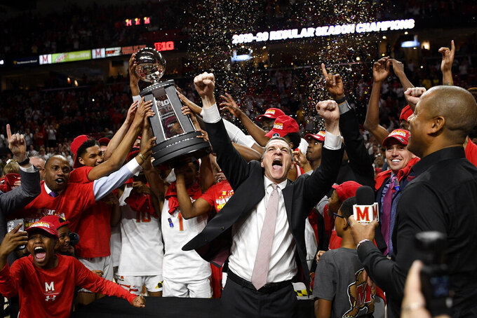 FILE - Maryland head coach Mark Turgeon, right center, and his team celebrate after they won a share of the Big Ten regular season title after defeating Michigan in an NCAA college basketball game in College Park, Md., in this Sunday, March 8, 2020, file photo. There would be no more basketball because of the spread of the coronavirus, making that the final game at Maryland for two of the key players on that team, guard Anthony Cowan Jr. and forward Jalen Smith.(AP Photo/Nick Wass, File)