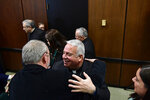 Archbishop-elect Nelson Perez, center, is embraced at news conference, Thursday, Jan. 23, 2020, at the Archdiocesan Pastoral Center in Philadelphia. Perez, the bishop of Cleveland, was introduced as the new leader of the Archdiocese of Philadelphia, making him the first Hispanic archbishop to lead the region's 1.3 million-member flock. (AP Photo/Corey Perrine)